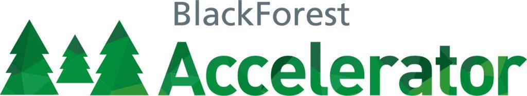 Das Logo vom Black Forest Accelerator besteht aus grauen und grünen Buchstaben sowie aus grünen Tannen